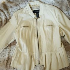 NWOT Cream Genuine Leather Jacket GORGEOUS cream leather with feminine details. 100% GENUINE LEATHER. Perfect coat to wear while the seasons transition!!!   No strains or tears! Never worn and in perfect condition. Could work for a 1X too. Ashley Stewart Jackets & Coats