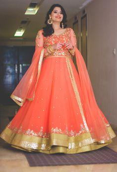 peach floor length anarkali , side slit full sleeves  engagement layered lehenga , Monika Nidhi shahpur jat