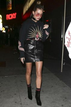 Hailey Baldwin wearing Balenciaga Patent-Leather Ankle Boots, Frame Denim Moto Skirt, Gucci Cotton Sweatshirt with Embroideries and Vetements Black Reebok Edition Classic Socks