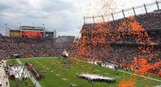 Balloons fly over Sports Authority Field at Mile High before a Denver Broncos football game - Denver, CO
