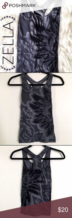 Zella • Black & Grey Floral Print Seamless Tank If you, like me, enjoy feminine details in fashion yet also have a slight obsession with darker color schemes, this is the yoga top for you! This seamless black and gray tank features an oversized floral design- you get the best of both worlds 😂 Racerback style straps with built in bra for extra support. Like new- I also have this tank's more colorful orange/red twin listed! Zella Tops Tank Tops