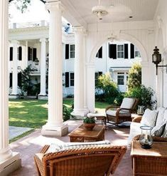 Elegant and stately yet cozy and inviting. Gorgeous porch with rattan furnishings.