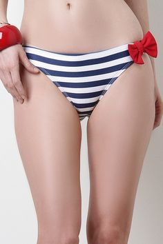 Miss Sailor Bikini Bottom. Go nautical in this Miss Sailor Bikini Bottom. This low rise bikini features a brief cut design, elasticized ruched back, accent with a red bow at left side, horizontal stripes throughout, and fully lined. Accessory sold separately. Made in U.S.A. 80% Nylon, 20% Spandex. Lining: 100% Polyester.Measurement   Size Hip Length   SML  1212.513  88.59