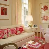 living rooms - cream sofa, cream couch, hot pink rug, cream curtains,  Pretty in pink  white sofa, pink floral pillows, acrylic lucite coffee