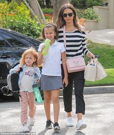 Family time: Jessica Alba was back in mom mode as she picked up her daughters Haven and Honor from school in Los Angeles on Tuesday