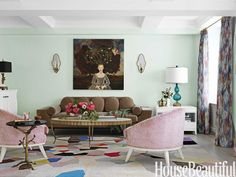 "To bring a feeling of nature into a New York living room, designer Fawn Galli used a custom minty green: ""I don't think a color should be too saturated or strong on a wall."" Pal + Smith chairs in a cheetah print — Safari by Manuel Canovas — with a Paley sofa from Profiles, a Fiona Curran Palette carpet for the Rug Company, and a painting by Anne Siems give the room ""a sense of storybook fantasy."""