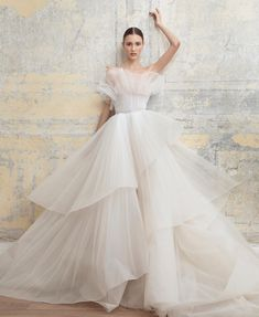 One of the most dreamiest wedding gown inspiration that caught our attention ✨ With layers of tulle and unique cutting, this gown by  is what dreams are made of. Who's dreaming to be wrapped in this impeccable dress? Leave a comment below! Boho Wedding Dress, Dream Wedding Dresses, Bridal Dresses, Wedding Gowns, Casual Wedding, Wedding Decor, Bridesmaid Dresses, Pretty Dresses, Beautiful Dresses