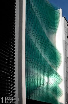 A façade of glass panels lit by fibre optic cables, the Mint Toy Museum, Singapore by SCDA Architects scdaarchitects.com