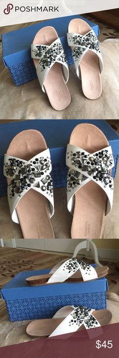 Authentic Vera Wang Slip On Sandal Authentic Vera Wang Slip On Sandal. New with box. Style SVelly. Color- White. It has stone accessories (see pictures for details). Size 6. Vera Wang Shoes Sandals