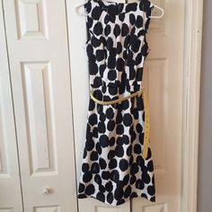 Beautiful black and white dress Beautiful black and white dress. Yellow removable belt adds a pop of color. Dress is approx knee length. Dress is size 8 but I believe it runs small. Material is thicker. Zipper in the back. Dresses