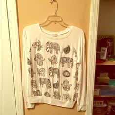 French Pastry Top Long sleeve, elephant top. The material is thin and see-through. Great condition. Sized x-large, but fits more a medium or large. French Pastry Tops Tees - Long Sleeve