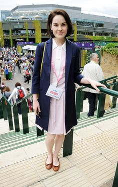 Michelle Dockery hung out in the Evian suite at Wimbledon, looking cute and sporty in a pink collared sundress.