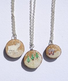 Wood slice snowglobe necklaces- polar bear, forest and snowy cabin designs, made from ash wood