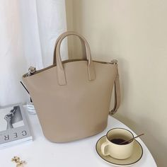 """Material: CowhideDimensions:Inches: Height 13.8"""" x Width 8.7~13"""" x Depth 5.1"""" Tote Handbags, Tote Bags, Leather Handbags, Shopper Bag, Black Tote Bag, Purses And Bags, Leather Totes, Annie, Jewel"""