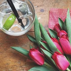 Flowers & Gin. Perfect combo.  #gin @preston_bar #tulips #woodenfloor #lazyweekend #sygmweekend #saturday by phoebewedding
