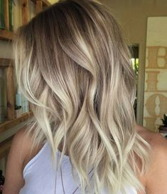 Light platinum balayage with golden lowlights and icy highlights.