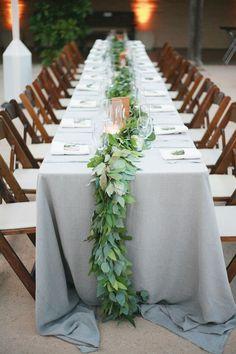 Gray and green wedding table setting.