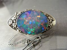 Lot 161 - Silver (c.1912) Black Opal Arts and Crafts Brooch by Edward Spencer (1872-1938), Principle