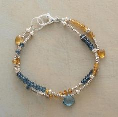 """Rondelles of butterscotch citrine and London blue topaz populate two strands, accentuated with the occasional briolette. Exclusive. Handcrafted in USA sterling silver beads. 7""""L."""