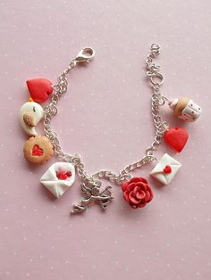 Adjustable Valentine's Day bracelet created from polymer clay  with charms: love letter, rose, Cupid, envelope with red and pink hearts, bird, lovely muffin and the red heart charm. The bracelet is fully adjustable and can be worn by adults and children as well.