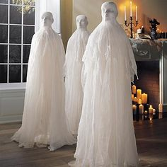 set a truly spectral scene in your home this halloween with the human ghost display separate them to thrill throughout your home or place them together to - Cheesecloth Halloween Decorations