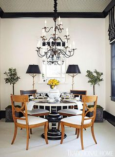 Love the black and white table pedestal, black and white Roman shades, and black and white striped skirt on the credenza! Striped fabric is Leather Stripe/Jet by Schumacher.