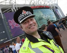 """Greater Manchester Police's Superintendent Jim Liggett on duty at Old Trafford football ground during the 2012 Olympics.    Assistant Chief Constable Terry Sweeney, Olympics Gold Commander, said:  """"Greater Manchester Police has been extremely proud to play its part in hosting a safe and successful Olympic Games.    """"Nine football matches have been held here at Old Trafford over the last seven days and we have welcomed more than 400,000 fans from all.""""  www.gmp.police.uk"""