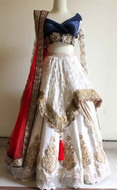 Anjali Mahtani Couture. White lace, red and navy bridal couture, south Asian bride, Indian wedding
