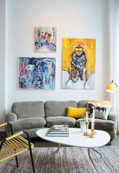 Cool art adds color to the basic white and grey interior.