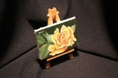 Dell's Phelps----orange yellow rose painting on easel