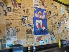 Vintage ads and newspaper clippings line the walls