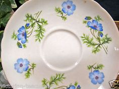 SHELLEY-TEA-CUP-AND-SAUCER-PEACH-COLOR-WITH-BLUE-FLOWERS