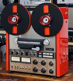 Teac A-7300 reel to reel recorder in orange.