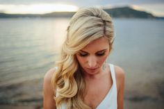 bride's hair Pulled to the side Tight on one side loose on the ither