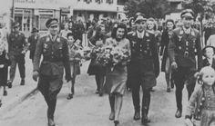 Ace of all aces Erich Hartmann's wedding Sept. 10, 1944. On his left is fellow ace Gerhard Barkhorn and on the right is Hauptmann Wilhelm Batz