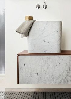 Warm, earthy yet modern stone bathroom vanity and sink