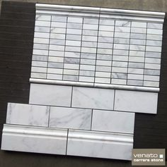 "$8.00SF Carrara Venato Honed 4x8"" Subway Tile along with 1x3"" Mosaic, Pencil trim, chair rail and Baseboard"