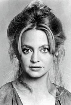 Goldie Hawn wearing the full and loose Gibson style bun popular in the '70s.