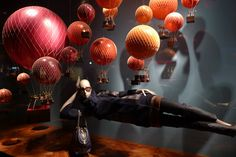 AnneM's: Visual Merchandising Love the floating mannequin with the balloons