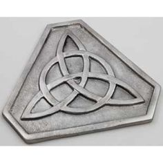"""Triquetra Altar Tile 5""""  Shaped into a triangle with flat corners to create a six sided tile, this altar piece presents a beautiful addition to your ritual crafts. Sculpted of silver-painted ceramic, it is light weight and delicate, with the classic Celtic symbol of a triquetra representing the Maiden, Mother and the Crone. 5""""x6"""" ... www.pagan-creations.com  Price.. $9.95"""