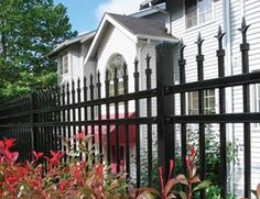 Our residential cedar fences are built to last. Whether you want a dog-eared fence, a chain link, board on board, or lattice fence, we have you covered. Stair Railing Design, Wrought Iron Fences, Image Descriptions, Lattice Fence, Cedar Fence, Stairs, Mansions, House Styles, City