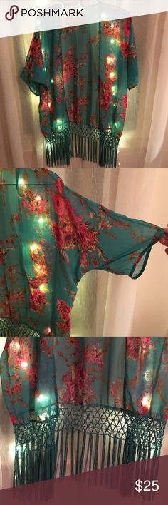 Floral beach sheer cover up 🌹☀️ Swim suit cover up. Color is a green/turquoise with pink and red rose pattern. Very feminine😍 Bought it for a trip and never had a chance to wear it Swim Coverups