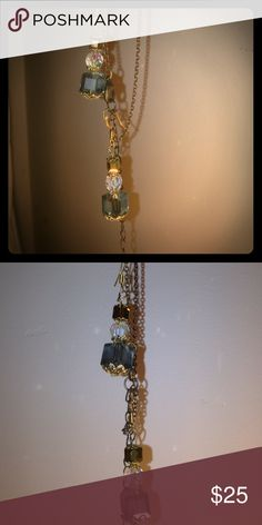 Three-tier aurora borealis airings Beautiful three tier aurora borealis earrings .gold square at the top followed by round egg clear aurora borealis third tier is a large square greenish smoky stone absolutely stunning Jewelry