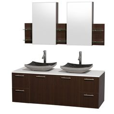 Modern clean lines and a truly elegant design aesthetic define this Amare vanity set from the Wyndham Collection. Two black granite basin sinks sit atop a striking white countertop then combine with rich, espresso wood to complete this bathroom decor.