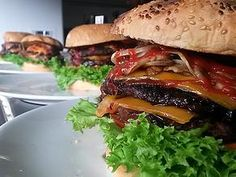 BURGERS All our Burgers are served with lettuce, tomatoes, grilled onions, ketchup and our special sauce.  * Clasic BetaBurgers * Ranchera BetaBurgers * Chiken BetaBurgers * Vegetarian BetaBurgers