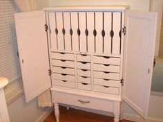 Custom Jewelry Armoire  Storage:  1 large bottom drawer  5 small drawers  9 vertical drawers for necklaces  10 large drawers    Measurements:  49in tall x 28.5in wide x 13in deep    SAGilson - Etsy