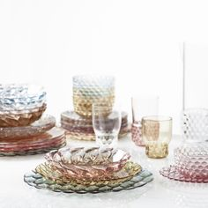 Kartell Jellies Family by Patricia Urquiola. A line of plates, trays, glasses, bowls and carafes made from colourful and transparent PMMA plastic. Each model presents a different organic pattern - inspired by nature,
