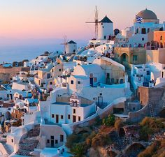 Whether it's the cotton candy #sunsets over the #Aegean or the ethereal whitewashed buildings, it's pretty much impossible to look at photos of #Santorini without #wanderlust kicking in.