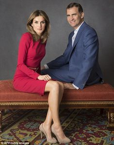 Elegant: Princess Letizia is pretty in red in this 2012 official portrait