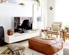 An Ottoman-Turned-Coffee Table Creates a Cozy Living Room Leather Pouf, Leather Ottoman, Pouf Ottoman, Square Pouf, Square Ottoman, Malm, Moroccan Pouf, Lounge, Cozy Living Rooms